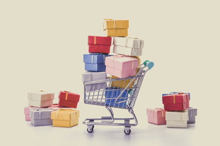 48038843 - colorful gifts box,supermarket shopping cart